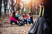 istock Eco friendly children collecting litter 1210845863