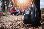 istock Eco friendly children collecting litter 1210919729