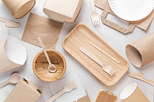 Eco friendly dishes. Disposable paper cups, dishes, fast food containers, wooden bowl and bamboo cutlery. flat lay. top view. recycling concept