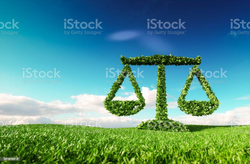 에코 친화적인 법률, 정치 및 생태 균형 개념. 푸른 하늘 배경에서으로 신선한 봄 풀밭에 규모 아이콘의 3d 렌더링. - 로열티 프리 개념 스톡 사진