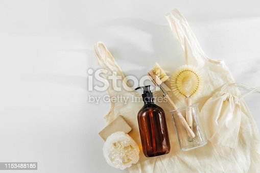 1169442284 istock photo Eco friendly natural cleaning tools and products, bamboo dish brushes and soap dispenser on white background. Zero waste concept. Plastic free. Flat lay, top view 1153488185