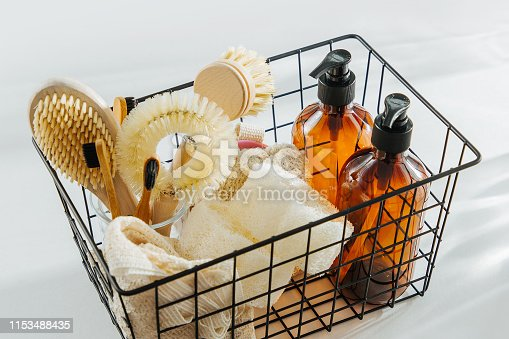 1169442284 istock photo Eco friendly natural cleaning tools and products, bamboo dish brushes and soap in black metal basket. Zero waste concept. Plastic free. Flat lay, top view 1153488435
