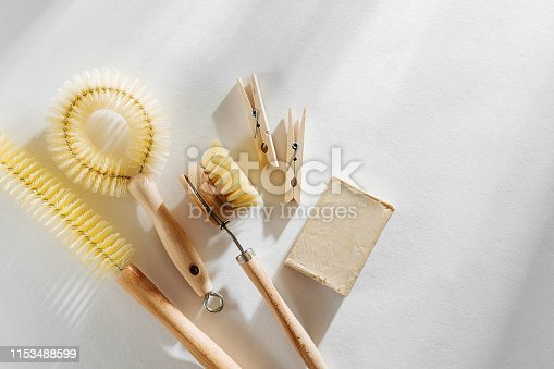 1168256931 istock photo Eco friendly natural cleaning tools and products, bamboo dish brushes and soap on white background. Zero waste concept. Plastic free. Flat lay, top view 1153488599