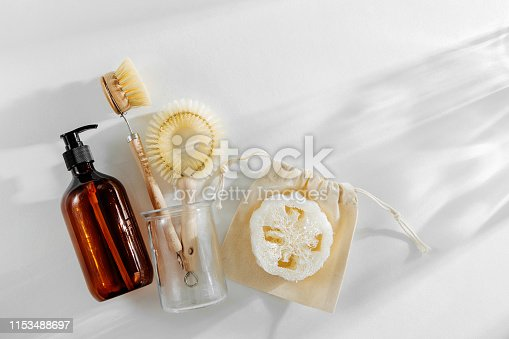 1169442284 istock photo Eco friendly natural cleaning tools and products, bamboo dish brushes and soap dispenser on white background. Zero waste concept. Plastic free. Flat lay, top view 1153488697
