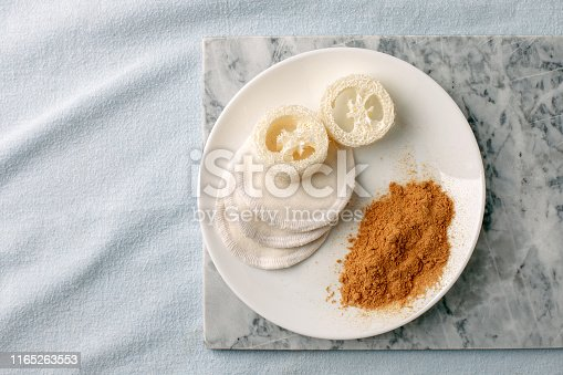 istock Eco friendly products for home cleaning, zero waste lifestyle, flat lay on white background. Mustard and natural luffa sponge on white plate, stylish minimalism 1165263553