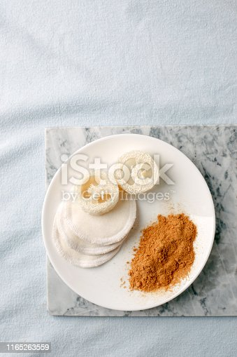 istock Eco friendly products for home cleaning, zero waste lifestyle, flat lay on white background. Mustard and natural luffa sponge on white plate, stylish minimalism 1165263559