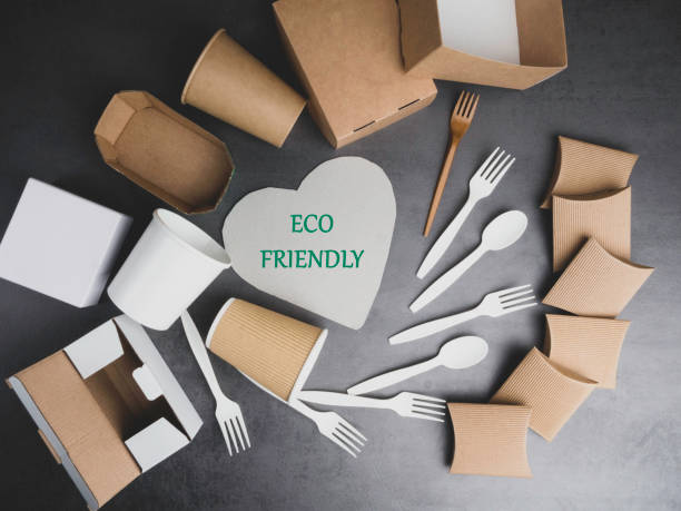 eco friendly recycling paper packing for fast food on grey background. cups, containers, box, table cutlery - biodegradabile foto e immagini stock