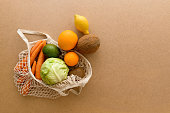 istock Eco friendly reusable mesh string knitted shopping bag with fruits and vegetables, zero waste 1154652778