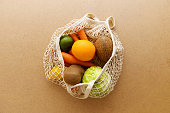 istock Eco friendly reusable mesh string knitted shopping bag with fruits and vegetables, zero waste 1154652792