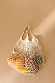 istock Eco friendly reusable mesh string knitted shopping bag with fruits and vegetables, zero waste 1154652824