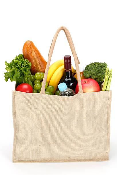eco amichevole shopping bag - fruit juice bottle isolated foto e immagini stock