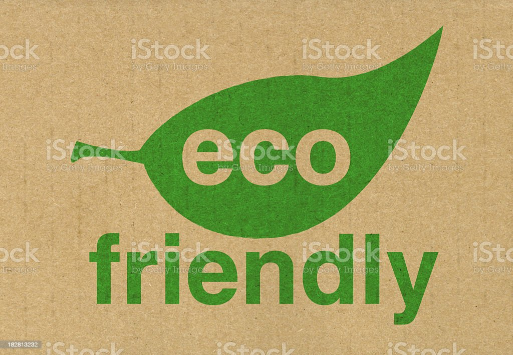 Eco friendly sign with green leaf on beige background royalty-free stock photo