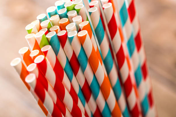 Eco friendly Stripped paper straws Striped paper straws in glass drinking straw stock pictures, royalty-free photos & images
