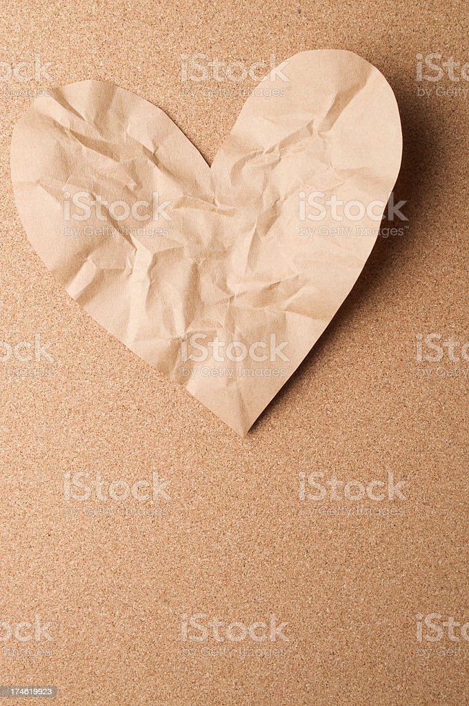 Eco Friendly Valentine Heart Brown Paper on Cork royalty-free stock photo
