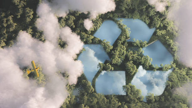 eco friendly waste management concept. recyclyling sign in a lake shape in the middle of dense amazonian rainforest vegetation viewed from high above clouds with small yellow airplane. 3d rendering. - coal stock pictures, royalty-free photos & images