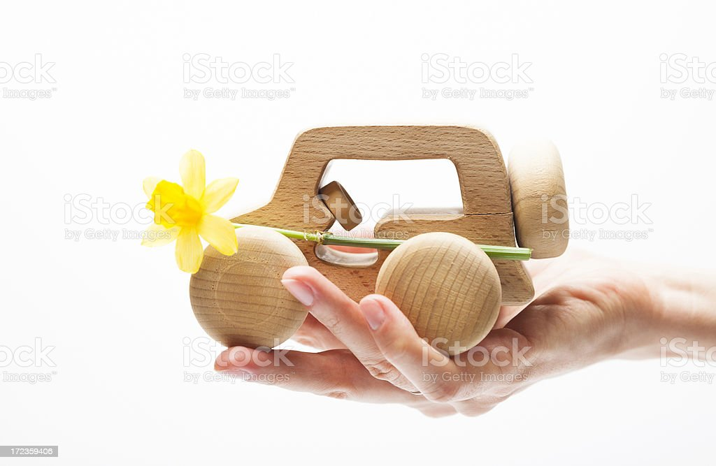 Eco Future Vehicle. Hand Holding a Wood Car Scale Model. royalty-free stock photo