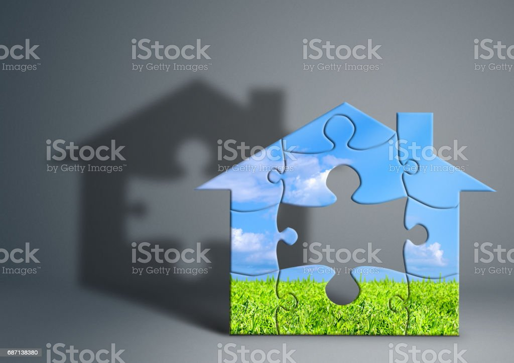 Eco green house concept, home from puzzle on grey stock photo