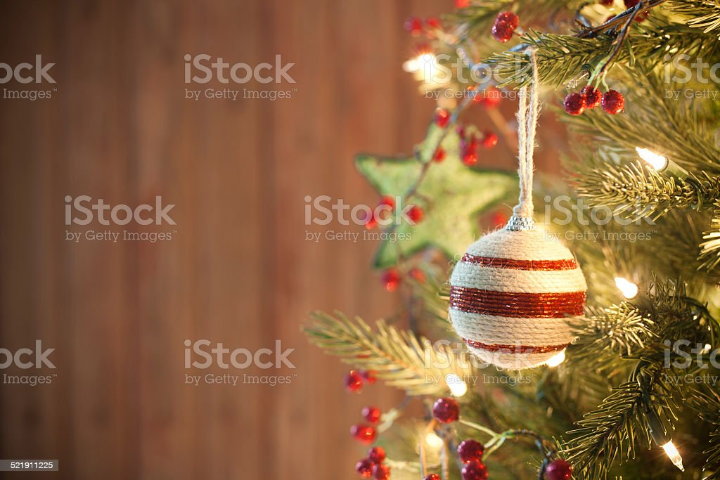 Eco Holiday Christmas tree, natural ornaments and wood door background