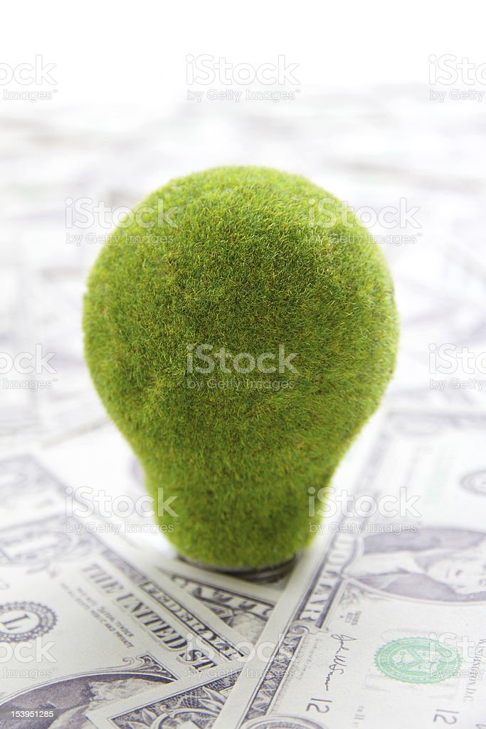Eco light bulb with cash concept royalty-free stock photo