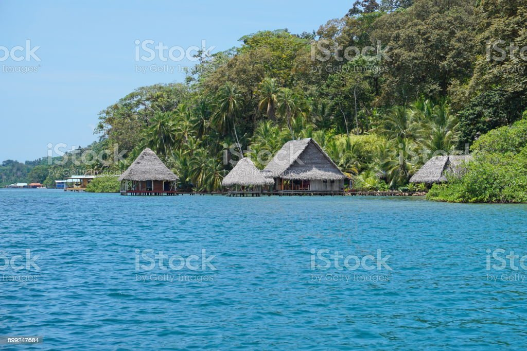 Eco lodge with thatched huts over the water Panama stock photo