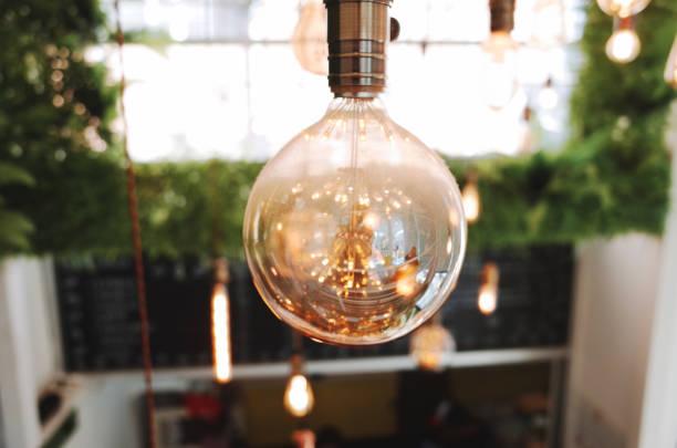 Eco modern home with Edison bulbs stock photo