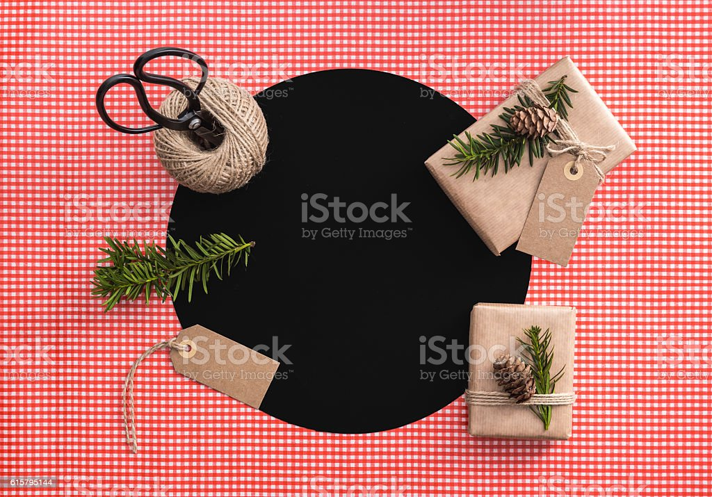 Eco presents. Gift wrapping set; scisors, string, branches, label, cones. stock photo