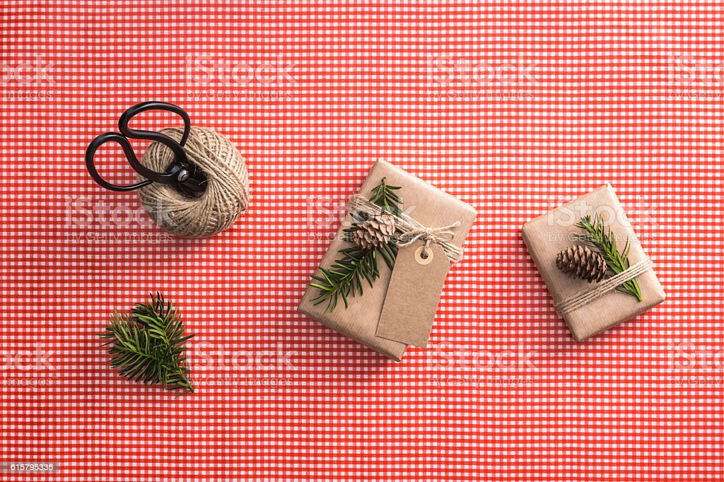 Eco presents on red checked background. Gift wrapping set. stock photo
