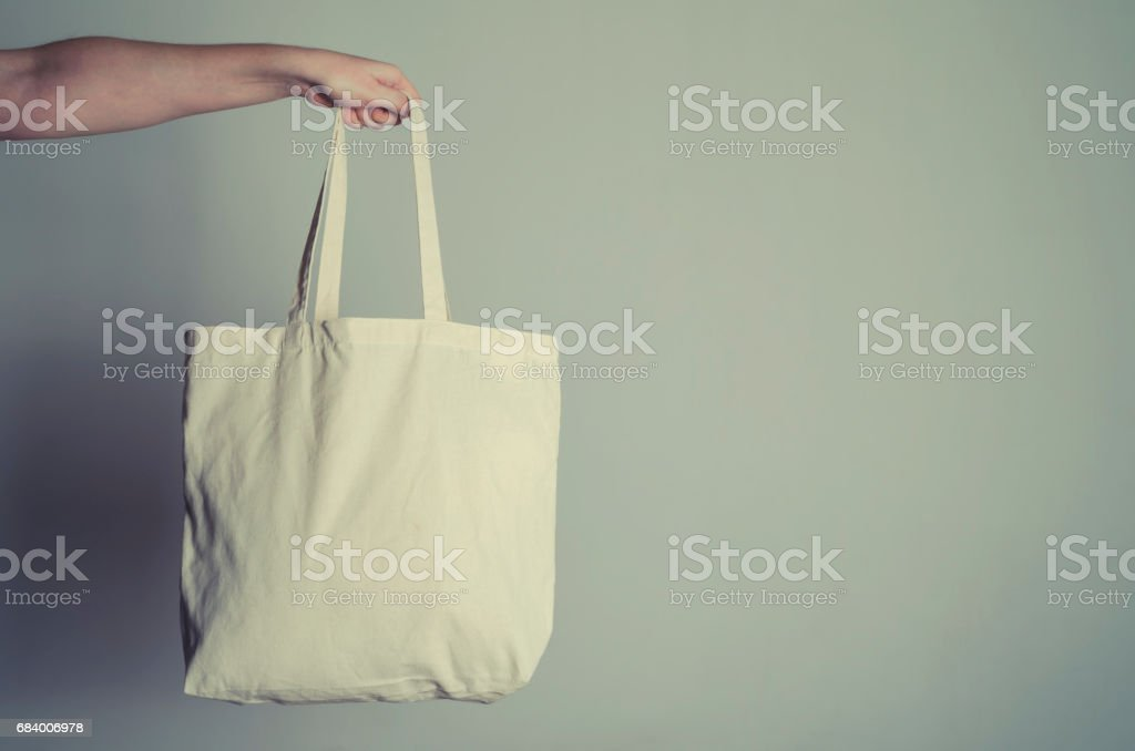 Eco shopping bag in hand stock photo