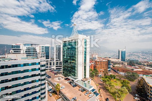 Kigali, Rwanda - September 21, 2018: a wide view looking down on the city centre with Ecobank and Pension Plaza looming in the foreground and Kigali City Tower in the background against a backdrop of distant blue hills