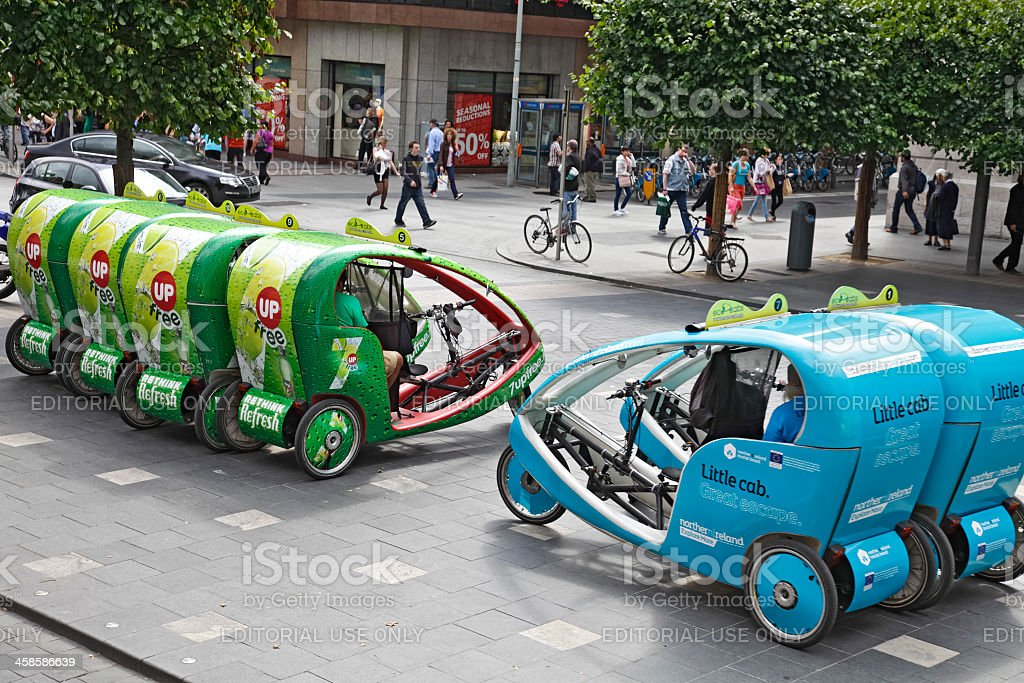 Ecocabs in O'Connell Street, Dublin, Ireland royalty-free stock photo