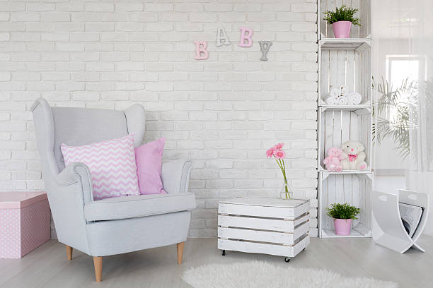 Eco-friendly baby room decor in white Fragment of a baby room with a white brick wall and DIY furniture made of wooden boxes magazine rack stock pictures, royalty-free photos & images
