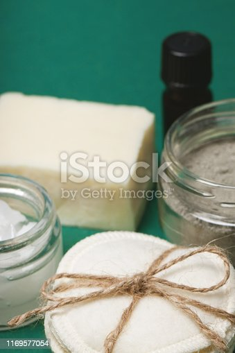 istock Eco-friendly body care items close up on the green background 1169577054