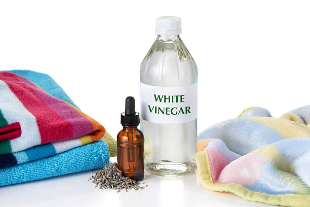 Eco-Friendly Fabric Softener All natural and eco-friendly fabric softener made with White Vinegar and Lavender essential oil. vinegar stock pictures, royalty-free photos & images