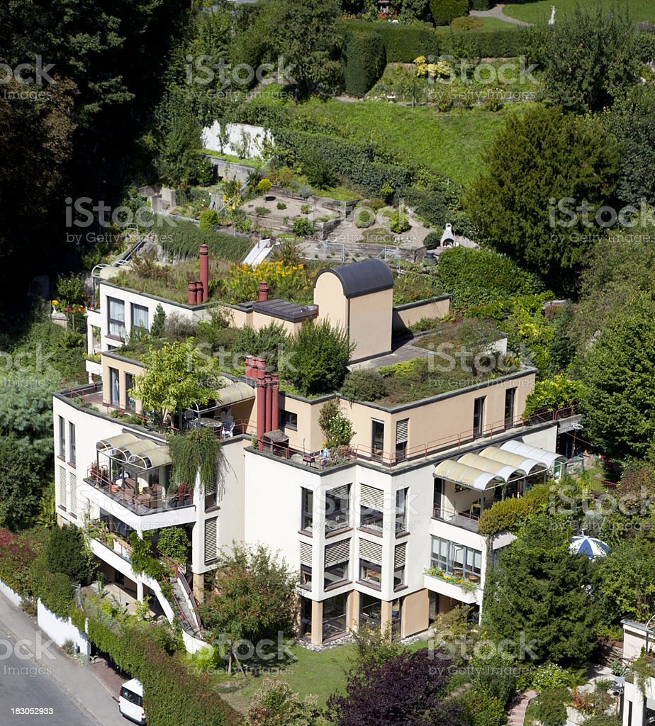 Ecofriendly Green Building with Roof Garden stock photo