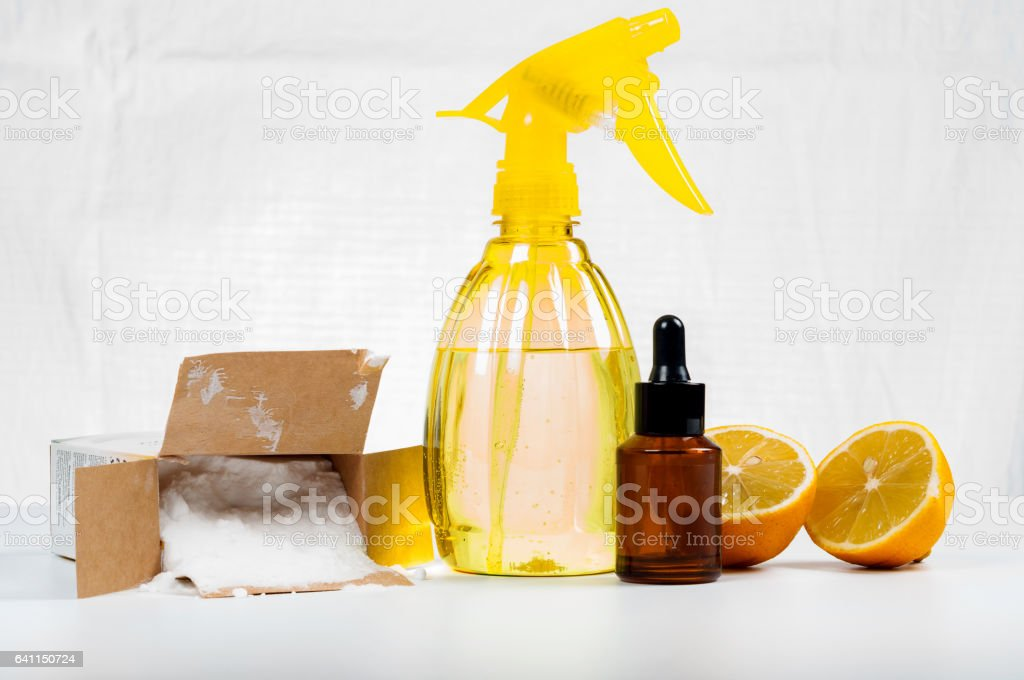 Eco-friendly natural cleaners made of lemon and baking soda on white wooden table stock photo