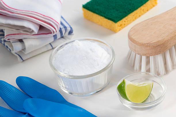 Eco-friendly natural cleaners Vinegar, baking soda, salt, lemon stock photo