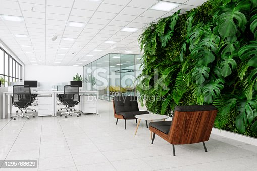 Eco-Friendly Open Plan Office And Waiting Area With Armchairs, Coffee Table And Vertical Garden.