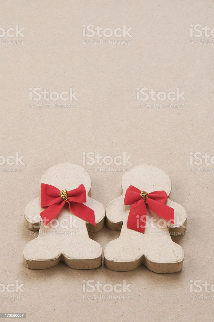 Eco-Friendly Recycled Cardboard Gingerbread Couple w Red Bows royalty-free stock photo