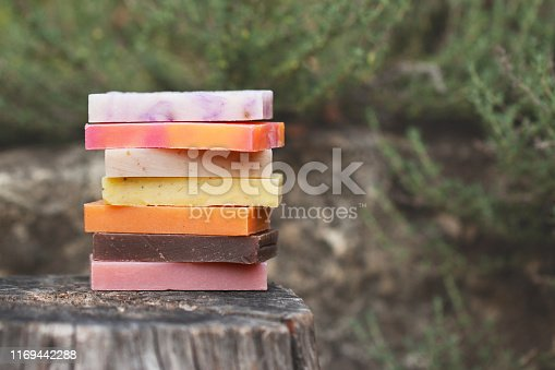 1168256931 istock photo Eco-friendly set of organic soaps on the natural background 1169442288