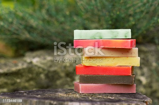 1169442288 istock photo Eco-friendly set of organic soaps on the natural background 1173446159