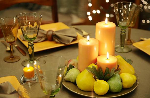 Eco-Friendly Table Decoration with natural colored candles, plates stock photo