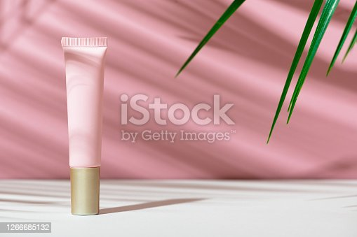 Eco-friendly tube with face cream. Women's care cosmetics with natural composition. Feminine hygiene product for facial skin care. Skincare, organic balm, soft lotion. Copy space, mockup.