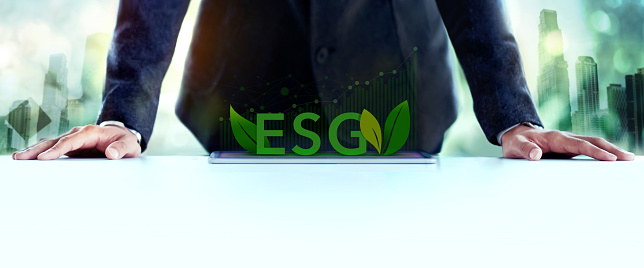 ESG, Ecology Care Concept. Environmental, Social and Corporate Governance. Businessman Planing an ESG Project on Tablet. Green Energy, Renewable and Sustainable Resources.