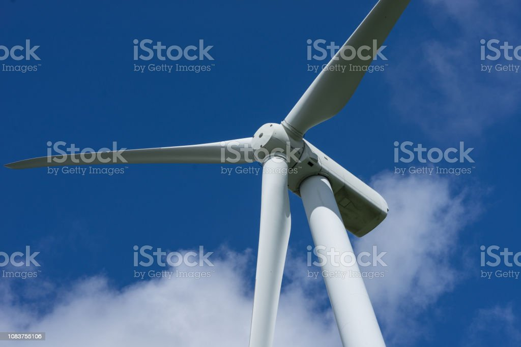 Ecology Concept Blue Sky White Clouds And Wind Turbine Wind
