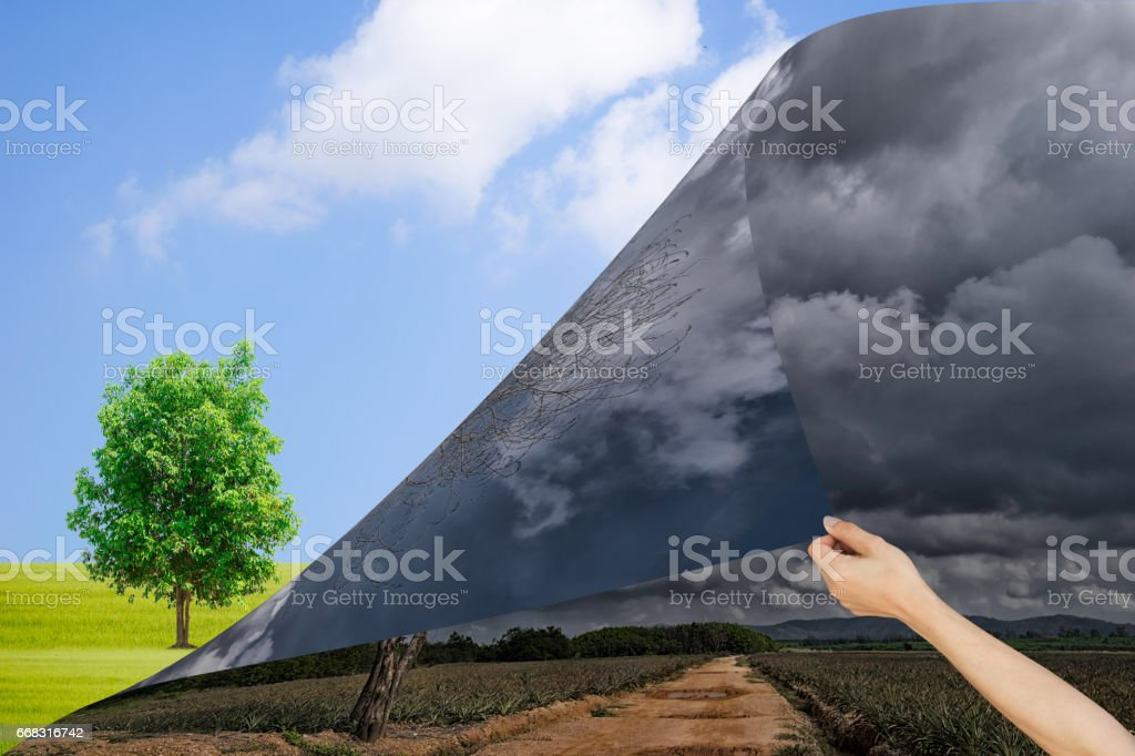 Ecology Concept Hand pull The dark sky and the fresh sky stock photo
