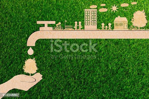 istock ecology concept of paper human hands holding plant tree No pollution Water and forest Clean energy water save 914348862