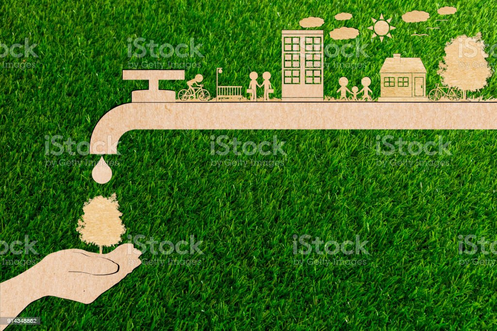 ecology concept of paper human hands holding plant tree No pollution Water and forest Clean energy water save stock photo
