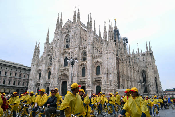 Ecology event of DHL courier in bicycles at the Duomo square. stock photo