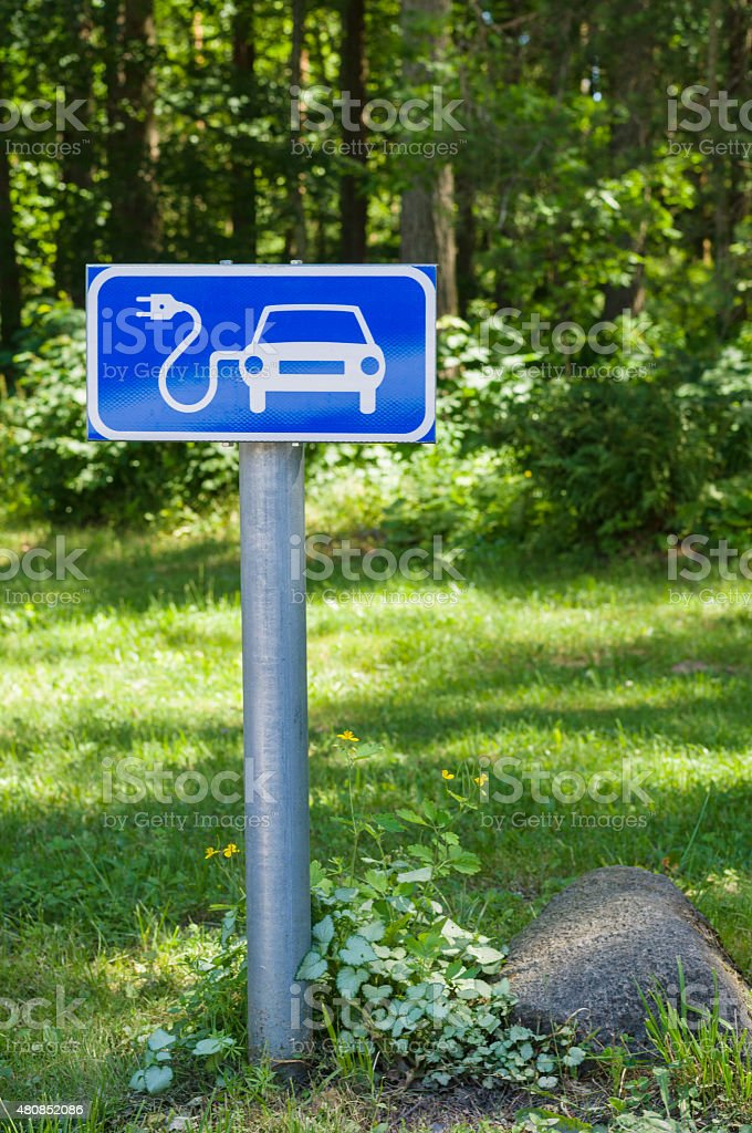 Ecology friendly electric car charging station road sign stock photo