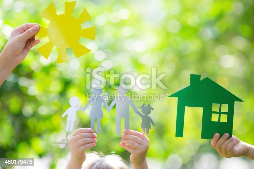istock Ecology house in hands 480179473